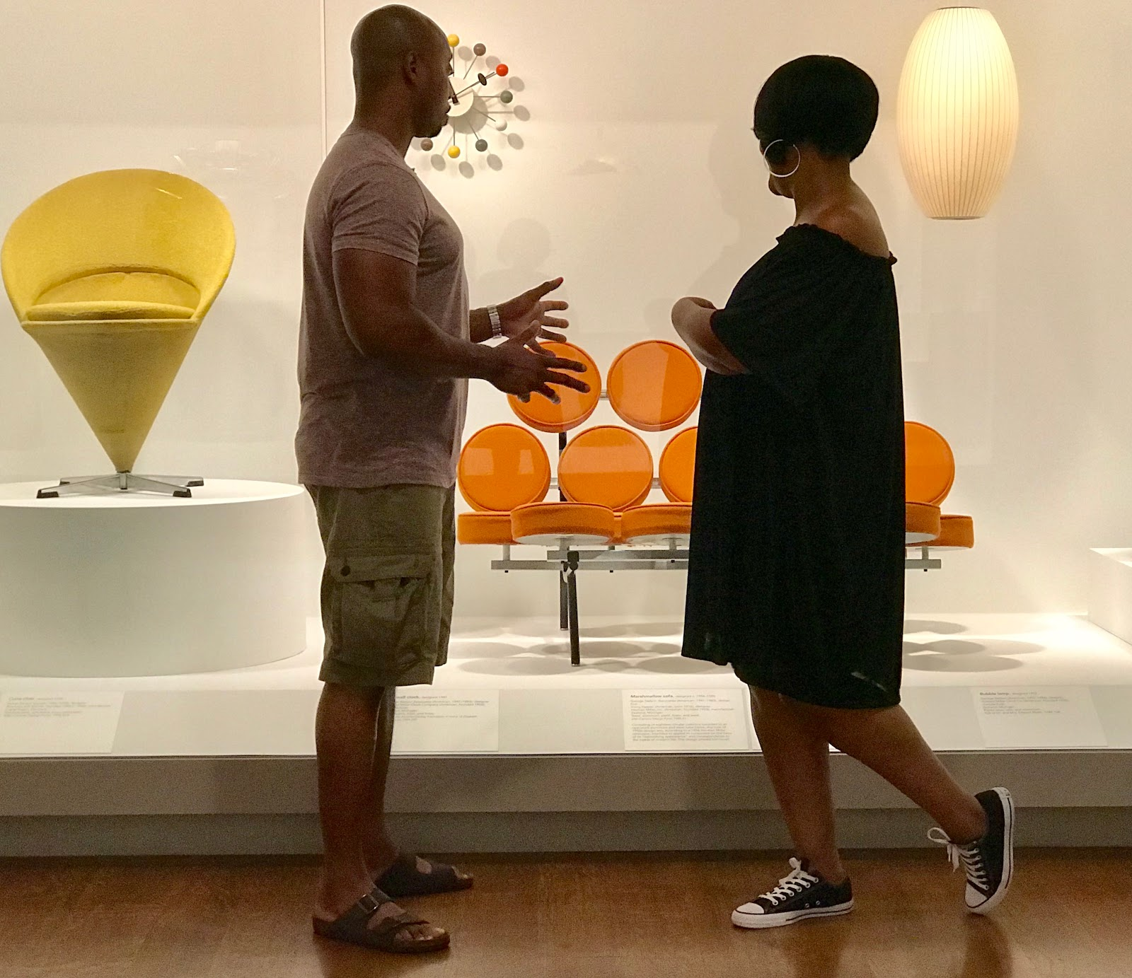 Couple enjoying the retro art at Dallas Museum.You will also find me and my bae (husband) in the retro, modern and back in the day furniture section. I have a fetish with orange colors. Our whole apartment is done in fall colors all year round. And I do not think I will ever change because the bright color makes me happy.