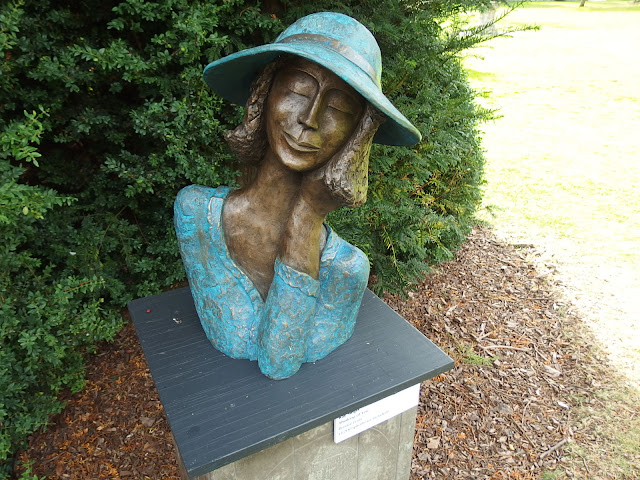Kay Singla's happy sculpture of a lady in a hat
