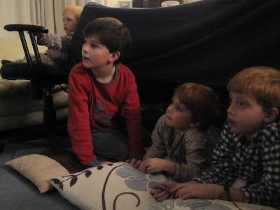 young friends watching a video in the dark