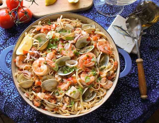 Food Lust People Love: Linguine Pecatore or fisherman's linguine features shrimp, squid, scallops, clams and mussels in a fresh tomato sauce tossed with pasta. This delicious main course is as fragrant as it is delicious. Squeeze on a little lemon juice for a bright, flavorful mouthful
