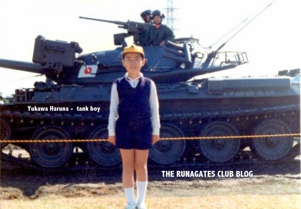 Yukawa Haruna - tank boy, a childhood pose in front of Japanese tank