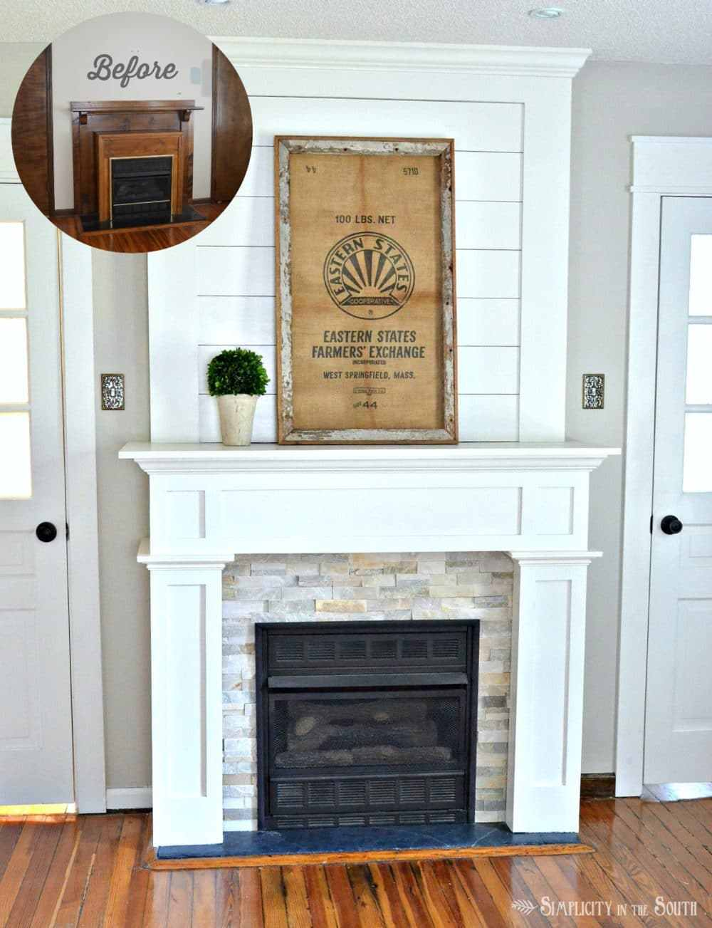 White fireplace with shiplap and stacked stone