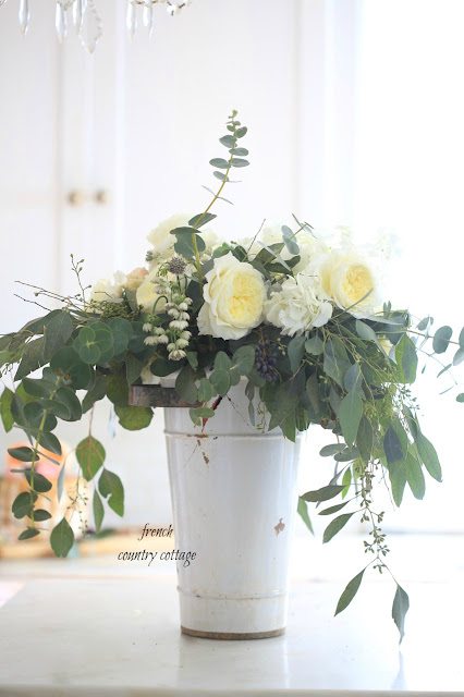 yellow and white flowers in vase in kitchen