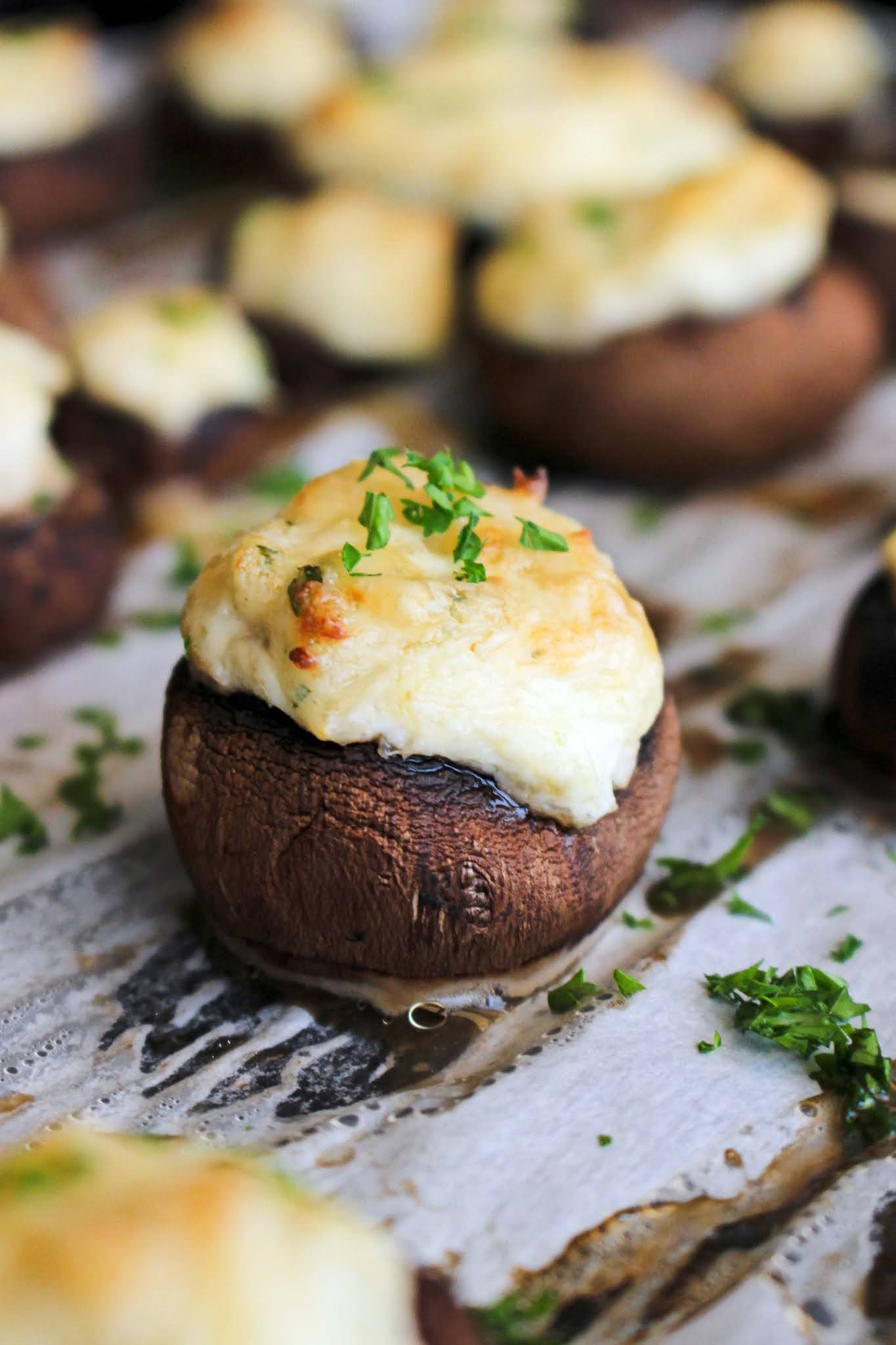 These are the best Crab and Cream Cheese Stuffed Mushrooms! They are elegant, yet easy to make and perfect for any occasion. Try them on Thanksgiving or Christmas! #stuffedmushrooms #crab #appetizer
