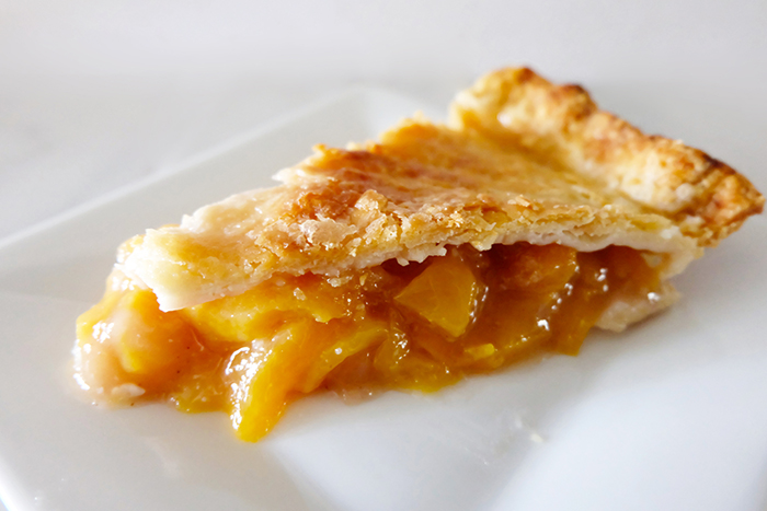 side view of peach pie slice