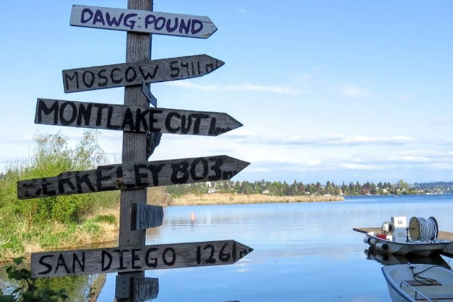 Seattle in a day:  wooden arrows pointing to places at Union Bay Natural Area