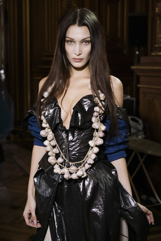 Bella walked down the runway in a necklace made of garlic