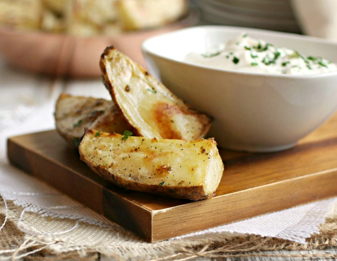 Recipe for an appetizer of potato wedges coated in a garlic and basil paste and roasted.
