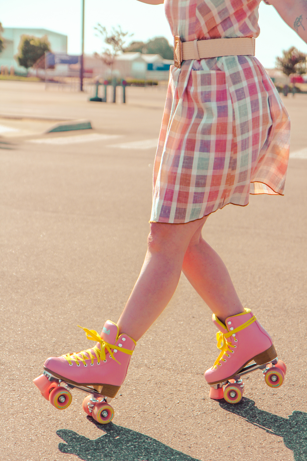 Liana of @findingfemme in Impala roller skates and check pastel dress.
