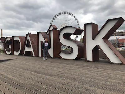 me standing in front of a metal sign spelling out GDANSK