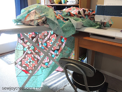 On Ringo Lake quilt adding borders ironing board support