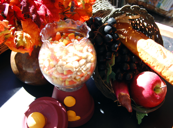 peanut candy corn snack mix with cornucopia and seasonal flowers