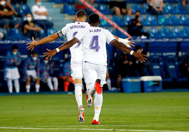 Real Madrid duo David Alaba and Karim Benzema celebrating a goal against Alaves