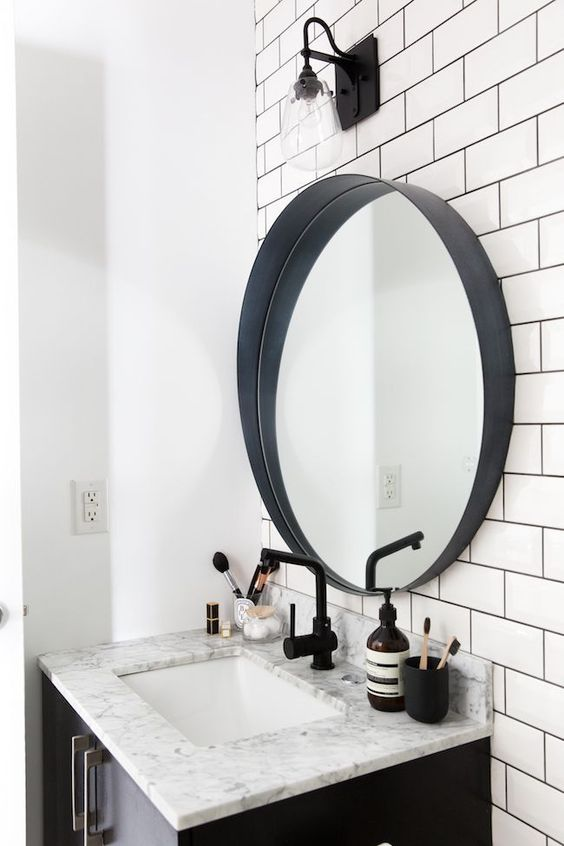 I think that round mirror its same you need in yout bathroom