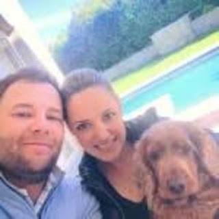 The Branden Couple With Their Dog