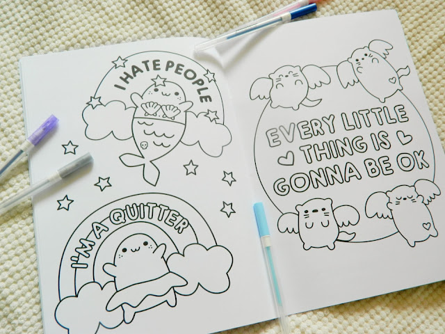 A photo showing uncompleted colouring pages feature cute animals and swear words