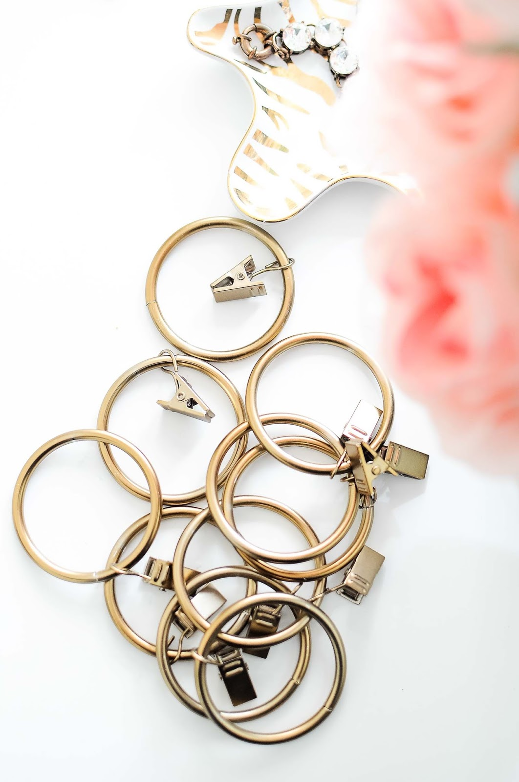 Affordable warm brass or gold curtain rings for large curtain rods.