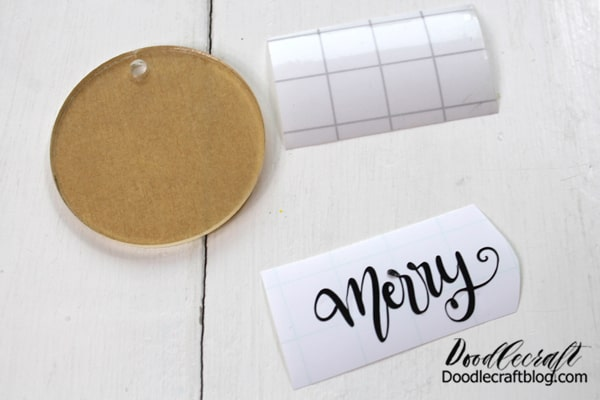 Then use the Cricut cutting machine to cut the vinyl. I picked the word Merry! The diameter of the blank is just under 2 inches, so the vinyl needs to be small--but pick a big word so it's less delicate weeding. Then weed the excess vinyl.