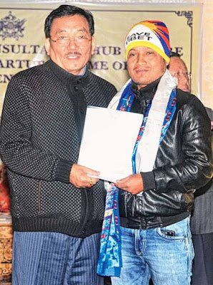 Pawan Chamling hands over a certificate to a young entrepreneur in Gangtok