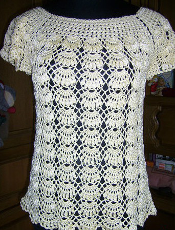 To live is to learn in this beautiful crochet blouse