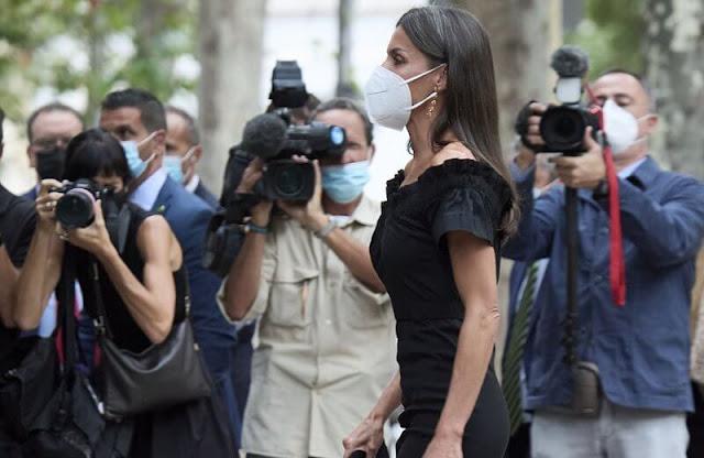 Queen Letizia wore a new Lolita black midi dress by Maria Malo. Sustainable dress. Carolina Herrera suede black pumps