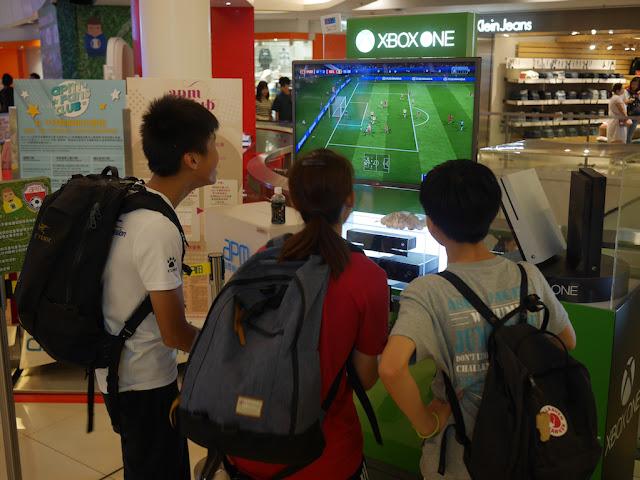 playing soccer on XBOX at apm Hong Kong