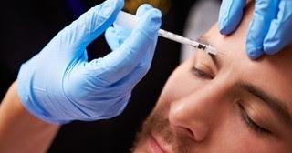 Man receiving Botox treatment in forehead at Beautox Bar Medspa Maple Grove