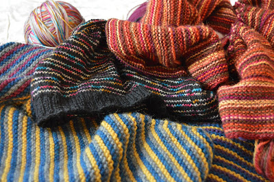 knitting stripes.  Striped scarf, striped cowl, striped shawl.  Hand knit items for sale at https://www.etsy.com/shop/jeanniegrayknits