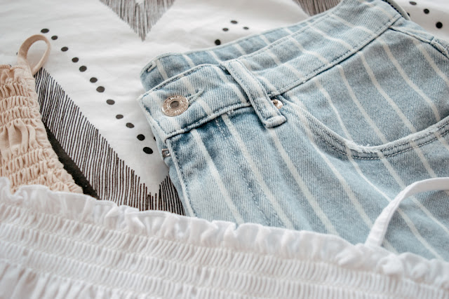 Detail on a pair of pinstriped shorts