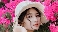 Beautiful Asian women pink flowers background