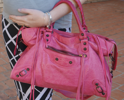balenciaga pink sorbet city bag worn on arm