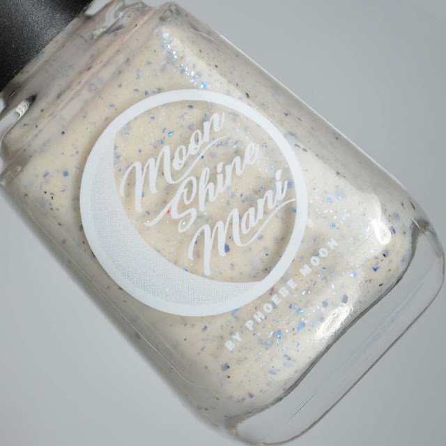 off white nail polish with flakies in a bottle