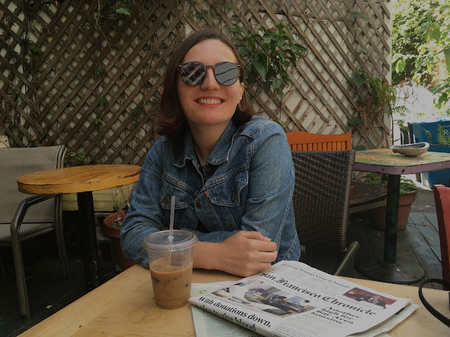 Drinking coffee at a cafe