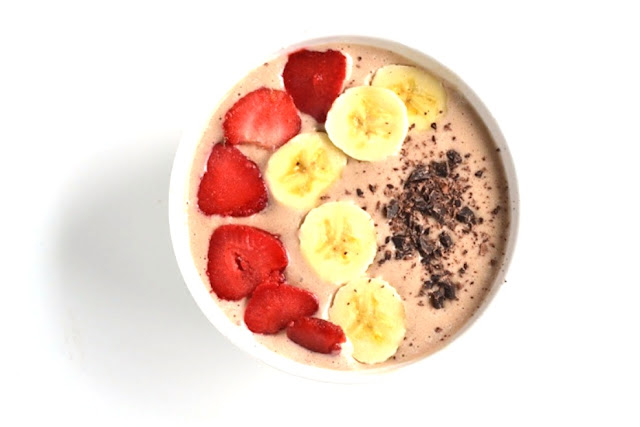 This Banana Split Smoothie Bowl tastes like your favorite dessert but is much healthier! It includes the traditional flavors including banana, strawberries and chocolate. www.nutritionistreviews.com
