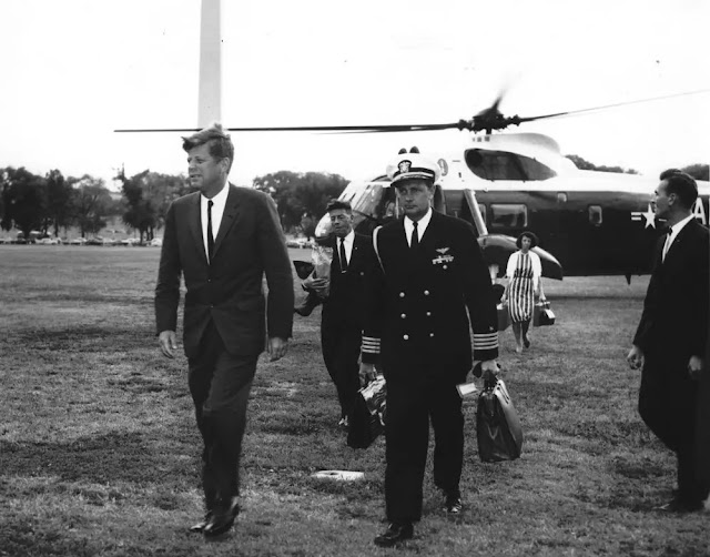 Former President Kennedy (left) and his aide carry the first nuclear suitcase.