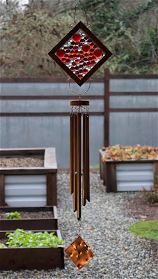 Red, purple, clear glass kaleidoscope wind chime with copper chime by Coast Chimes
