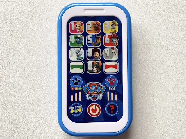 A close up of the PAW Patrol toy mobile phone