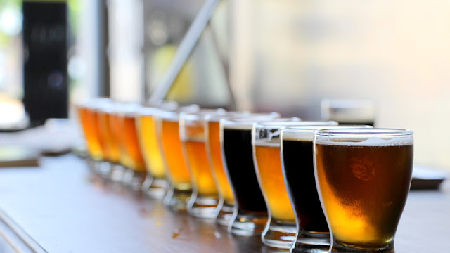 a colorful lineup of craft beers