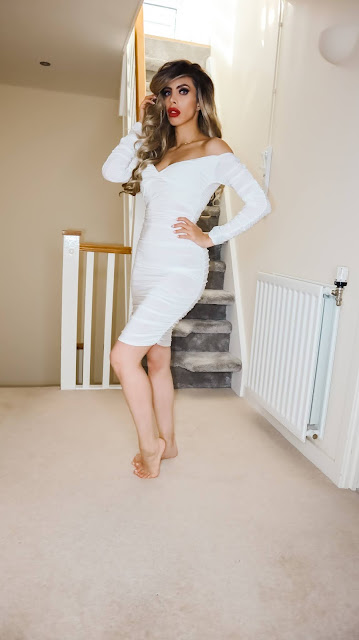 The Femme Luxe White Ruched Bardot Long Sleeve Bodycon Mini Dress in model Mindy