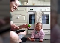 Baby laughing at a ball is the joy you need