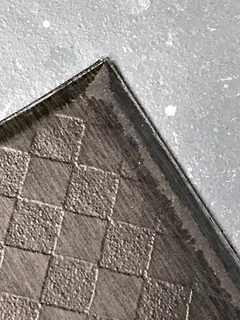 corner of an old worn kitchen mat
