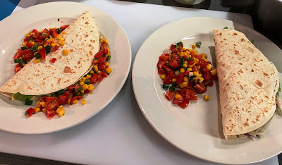 Two plates of tacos with chunky salsa