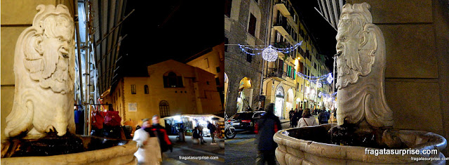 Fonte com mascheronne em uma esquina de Florença