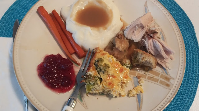 Plate with turkey, broccoli casserole, mashed taters and carrots