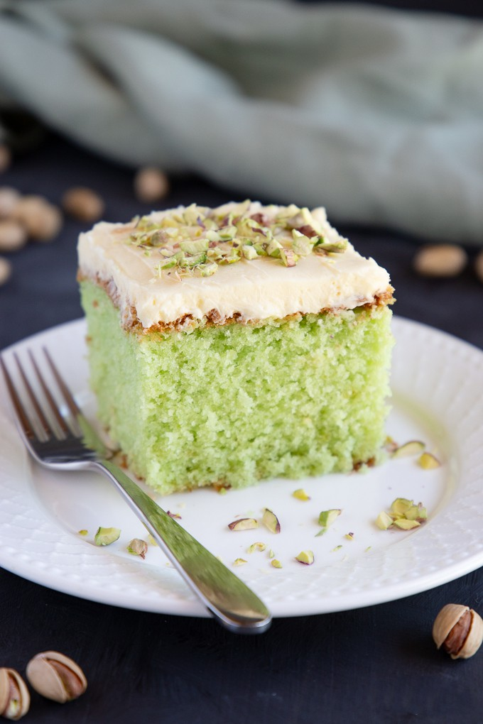 Best Ever Pistachio Pudding Cake - This Best Ever Pistachio Pudding Cake is so moist and flavourful with the perfect combination of pistachio and cream. A tender pistachio-flavoured cake is topped with a simple cream cheese frosting and crushed nuts!