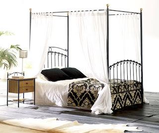 cama de forja vintage con dosel