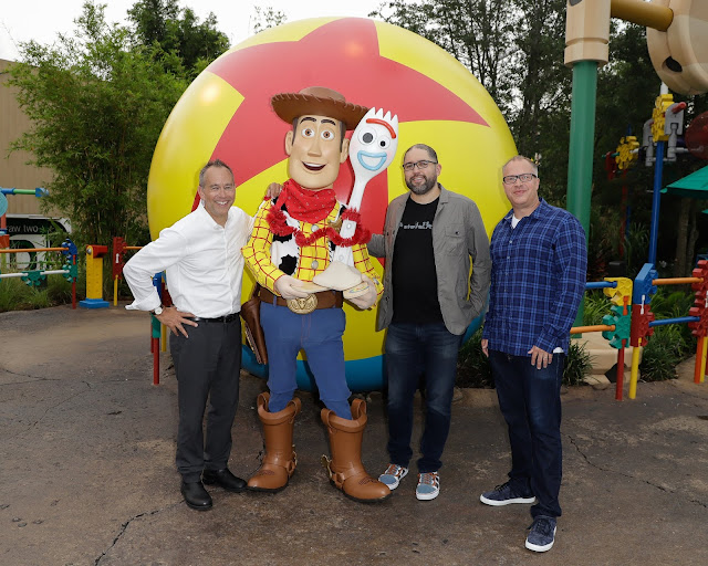 Director Josh Cooley, Producers Jonas Rivera and Mark Nielson take photo with Woody and Forky at Toy Story Land