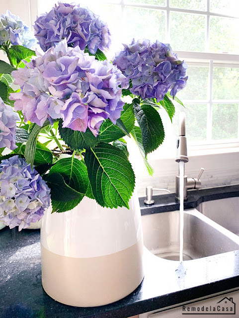 purple hydrangeas close to the sink