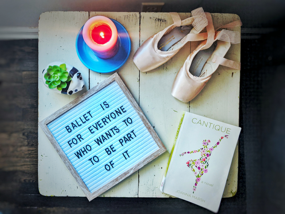 Letterboard that reads: Ballet is for everyone who wants to take part in it, and the novel Cantique by Joanna Marsh