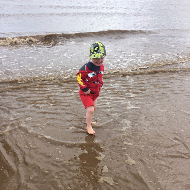 Little boy paddling in the sea